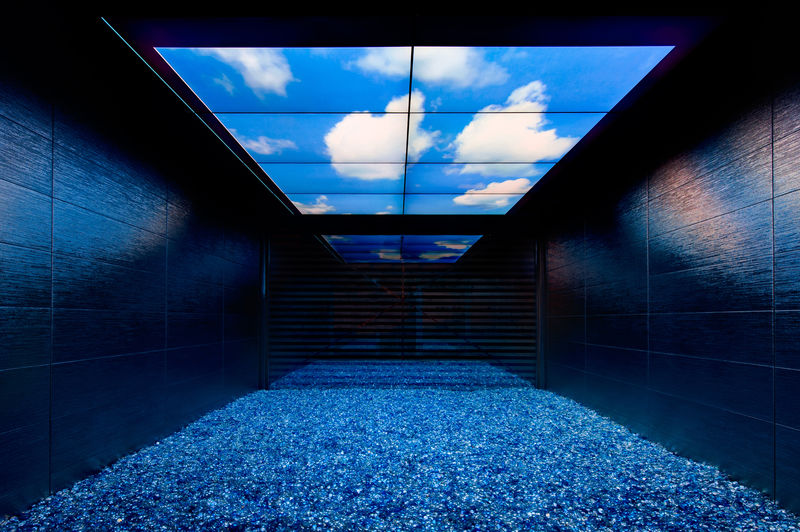 View through a long skylight out towards a blue sky with white clouds at Backstage Hotel in Switzerland
