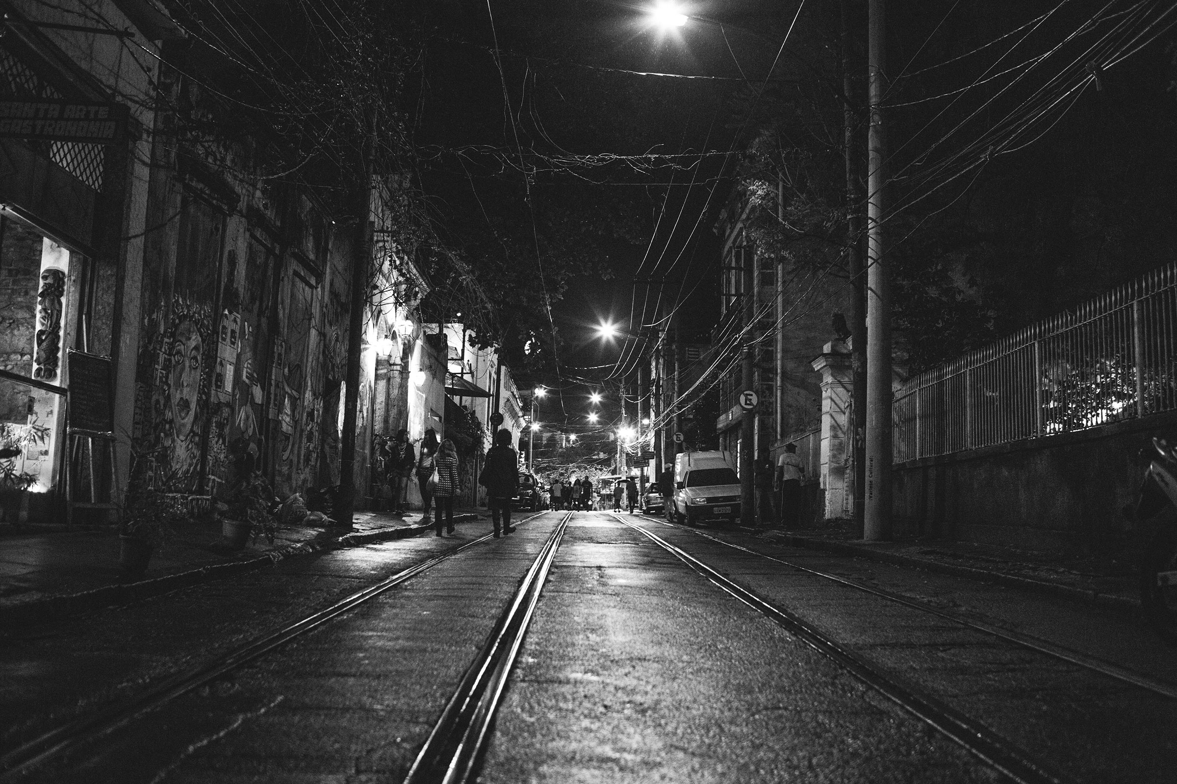 Rio trip:A view of a deserted street with tram tracks and grafitti on the walls, Rio De Janeiro