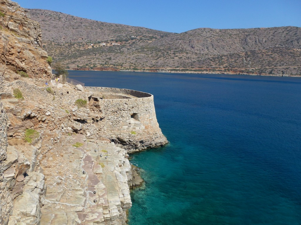 The walkway on the ancient wall encircling the island of Spinalonga in the Gulf of Elounda, Crete, Greece.