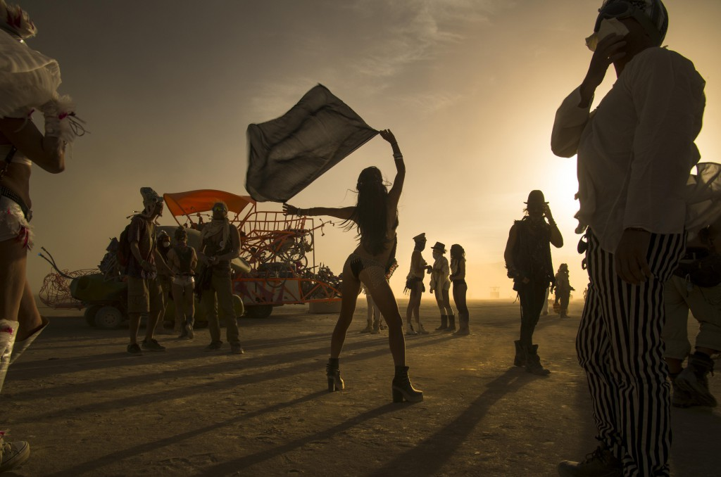 Sihouetted revellers at a Burning Man wedding, Black Rock, Nevada