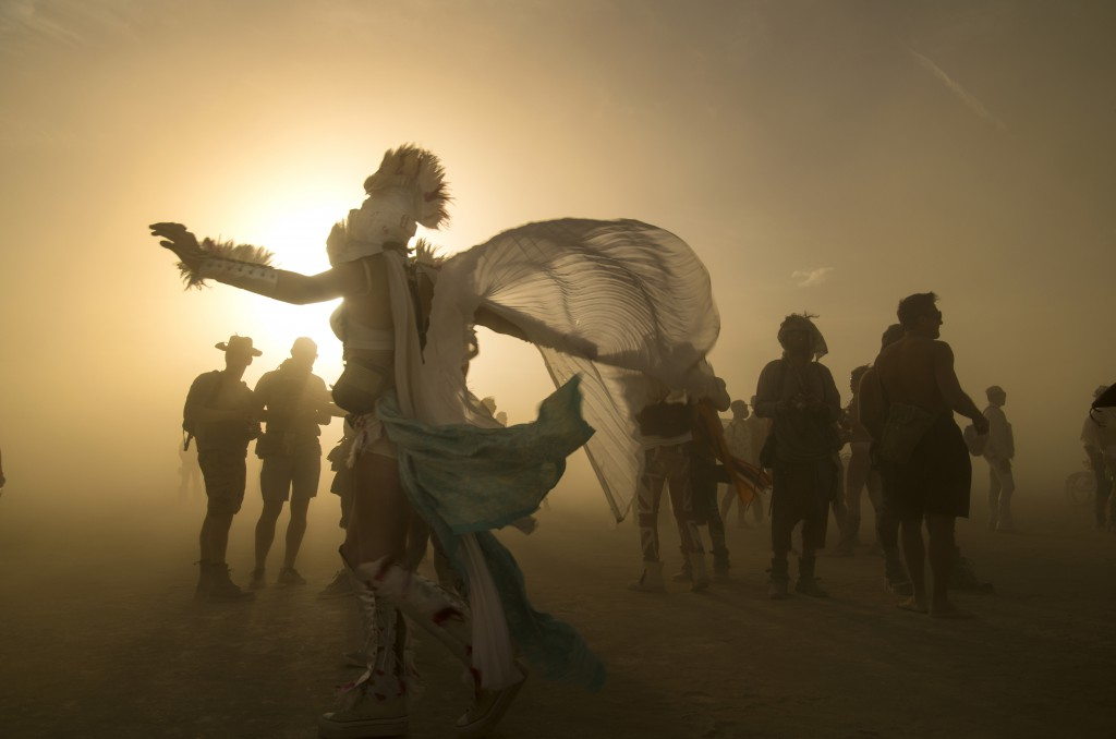 Person in a billowing costume sihouetted against the setting sun at Burning Man, Black Rock, Nevada