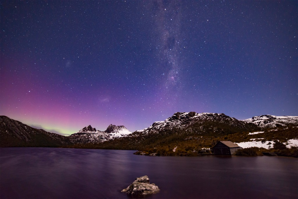 A view of Cradle Mountain across the water at Lake St Clair National Park, Australia at night
