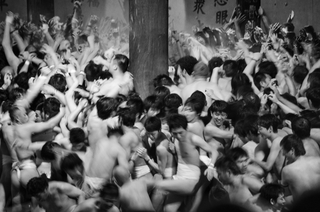 Hadaka Matsuri, Japan During this 'Naked Festival', held in February in Okayama, almost 10,000 men crowd together, forming a colossal mosh pit of hope and kinship. Clad in white loincloths, they purify their bodies with cold water and cram together to try to grab a pair of lucky wooden sticks (shingi) thrown by a priest. Each member of the vigorously chanting crowd believes that a year's worth of good luck comes to whoever catches the shingi. Reaching out in boisterous anticipation, each man hopes the luck will come to them. Photo by Kurt K. Gledhill