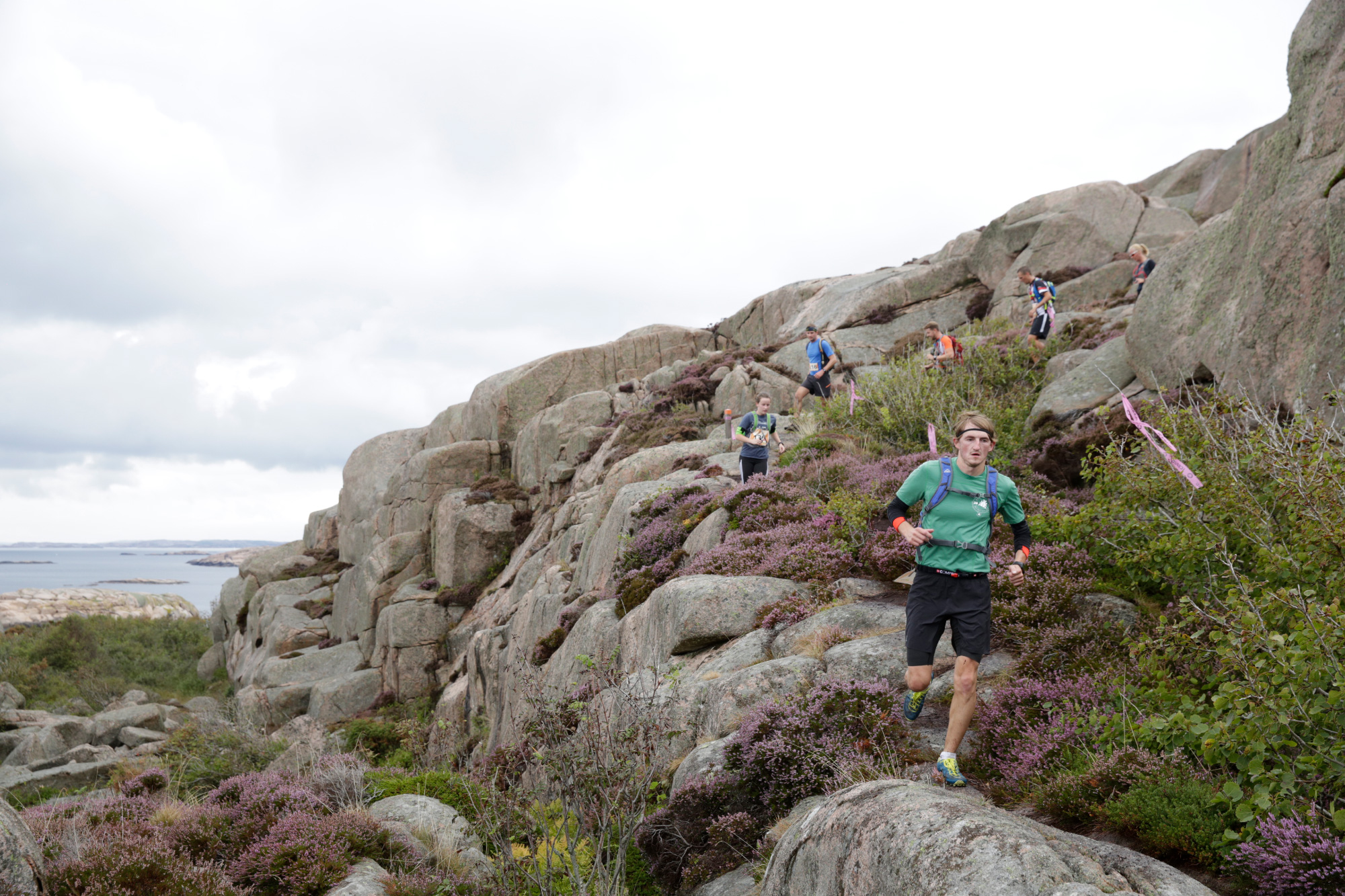 Runners running single file down a rocky hillside on the Icebug Xperience marathon