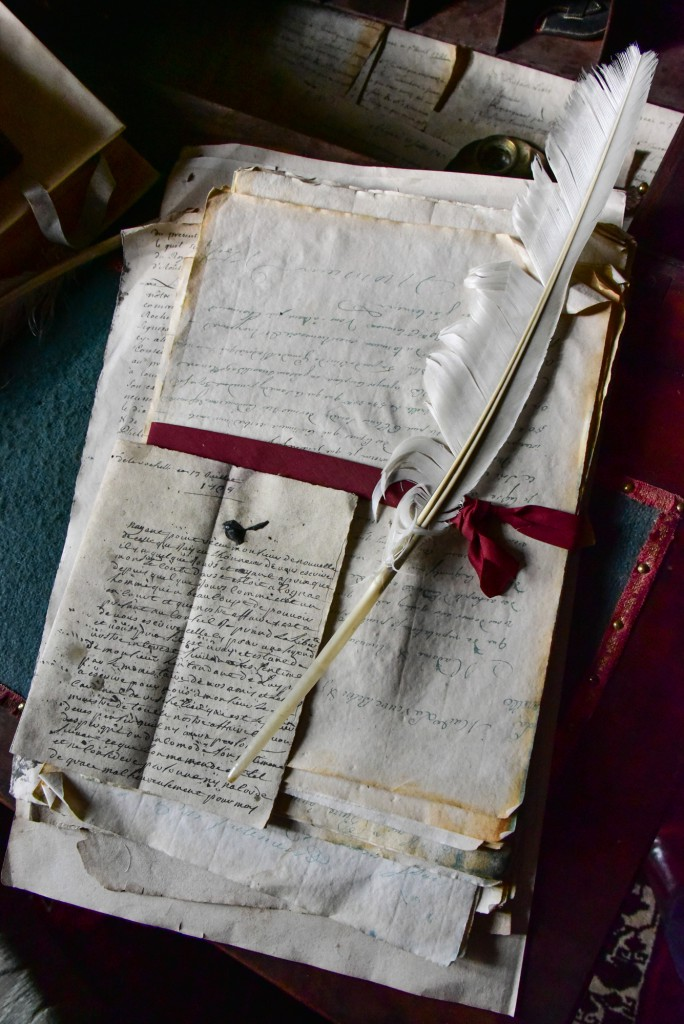 Jean Martell's log books, invoices and letters tied with a red ribbon and a white quill on top, Cognac, France