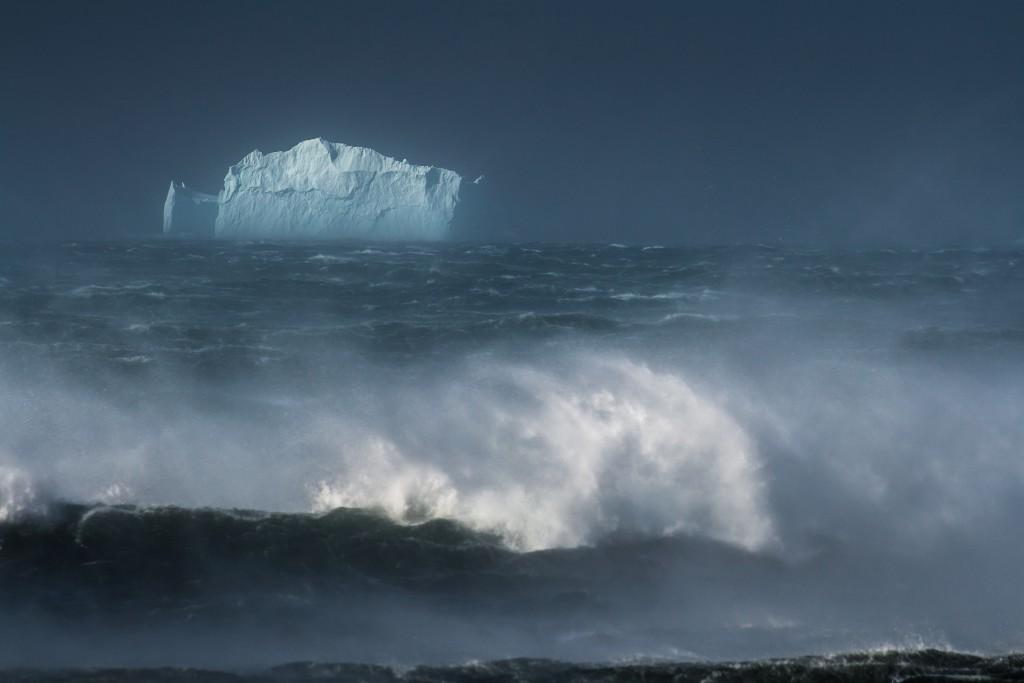 Massive iceberg in a stormy sea