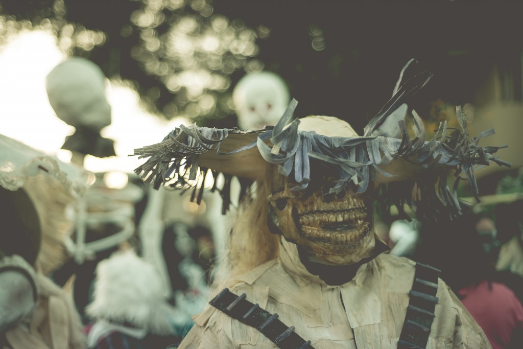 Reveller in a skull mask for Day of the Dead in Mexico