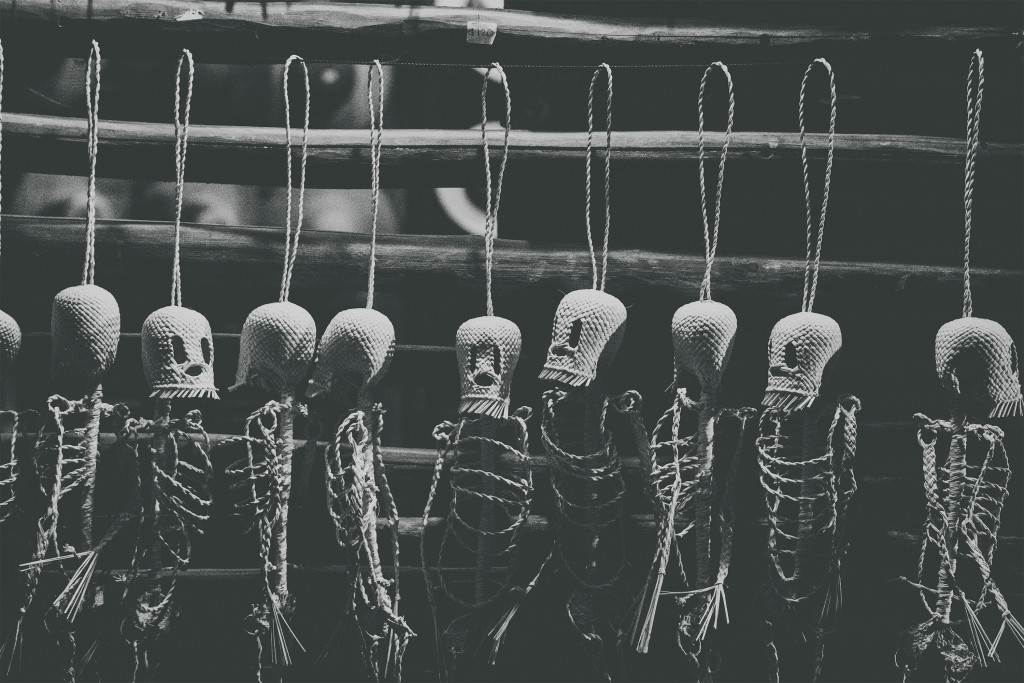 Little skeletons made of wire hung in a row on a fence for Day of the Dead in Mexico