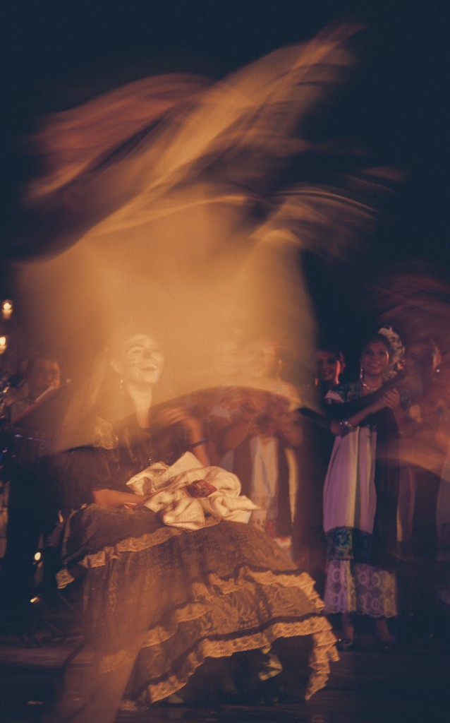 Soft hazy picture of a laughing woman dressed in traditional clothes at Day of the Dead, Mexico