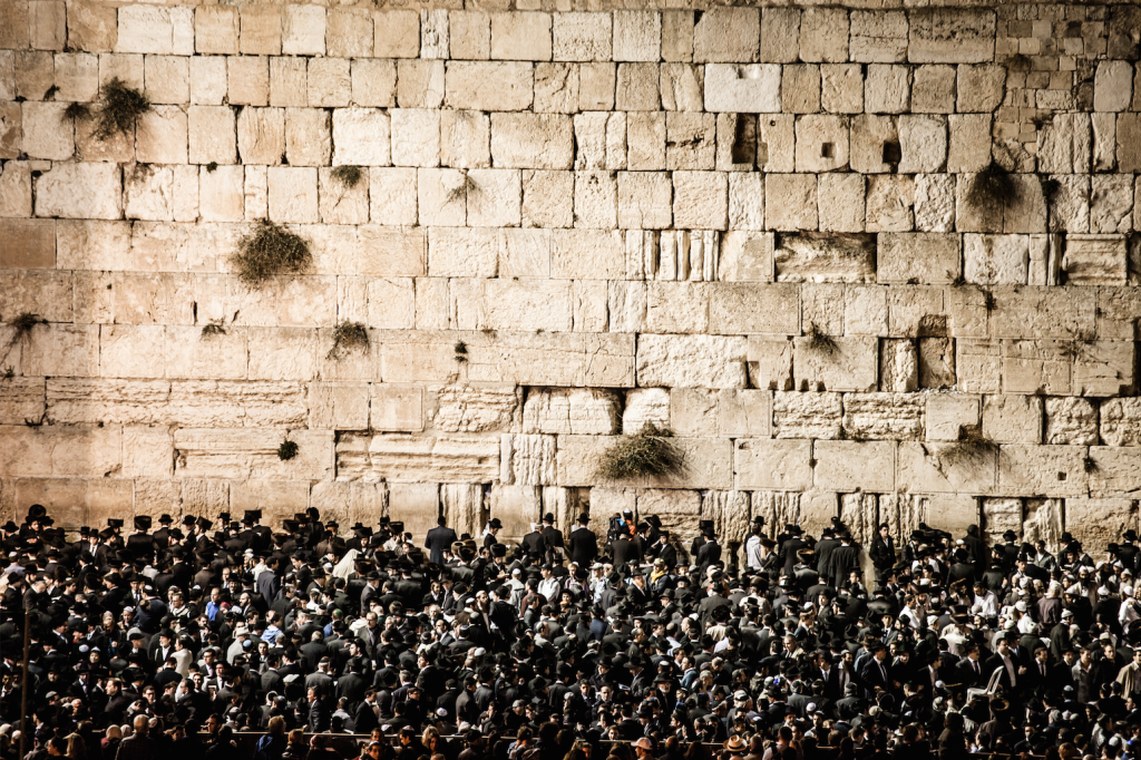 Jerusalem Conquered, destroyed, recaptured and rebuilt: the layers of Jerusalem's history represent a plateau of monotheistic religions. Despite centuries of division and dispute between Christianity, Islam and Judaism, these religions are united by shared Abrahamic origins and by their mutual preoccupation with this holy city. This photo depicts prayers at the Western Wall Photo by Mariusz Prusaczyk