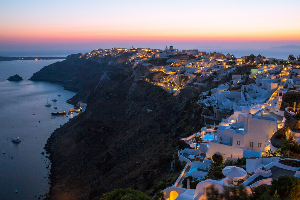 Iconic Santorini rests against the caldera at sunset.
