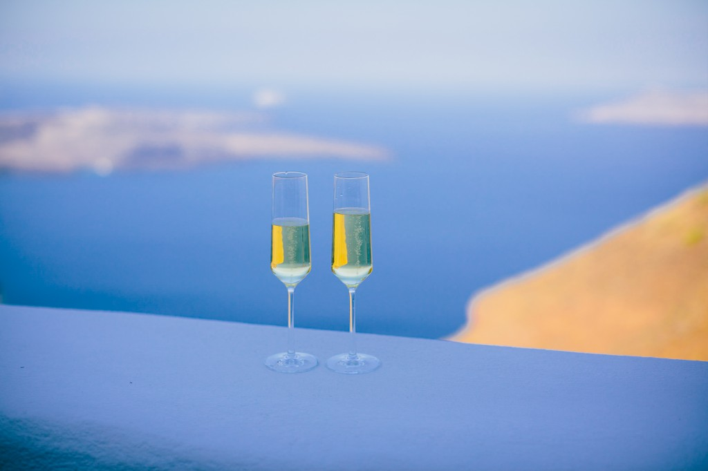 Chilled champagne rests on the caldera at Iconic Santorini in Imerovigli.