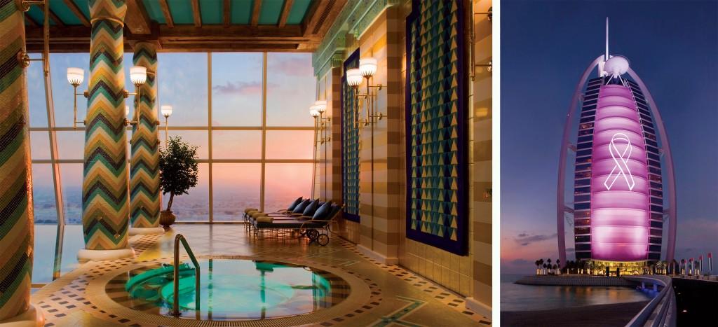 "Innovative Hotel Design: The ""billowing sail"" of the Burj Al Arab in Dubai lights up the night sky."