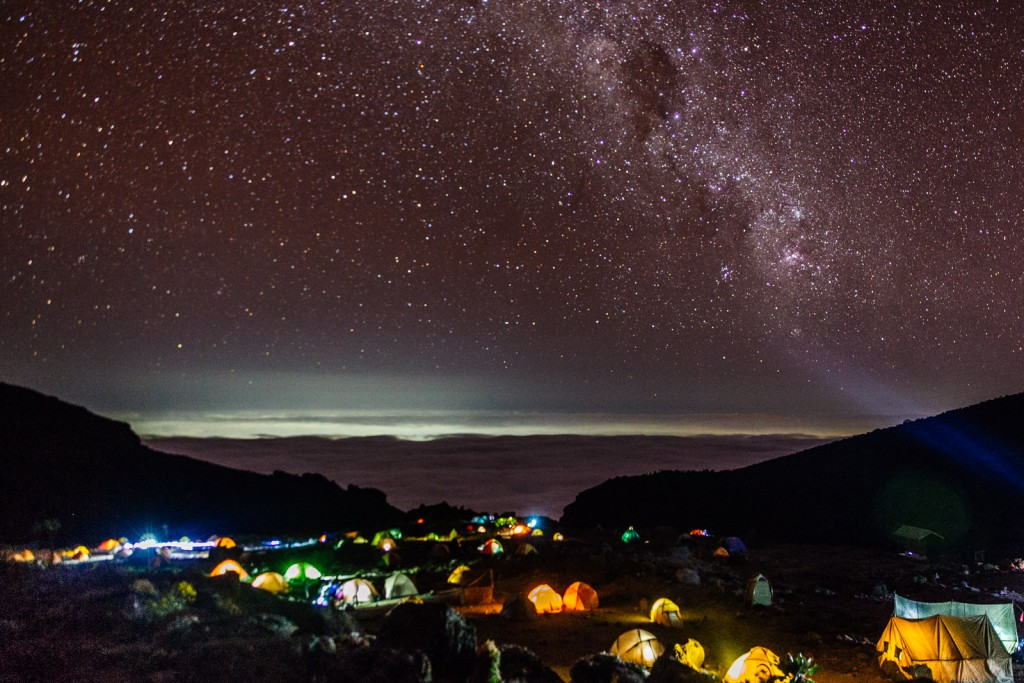 At nightfall each campsite on Mt. Kilimanjaro is aglow with clusters of jewel-like tents.