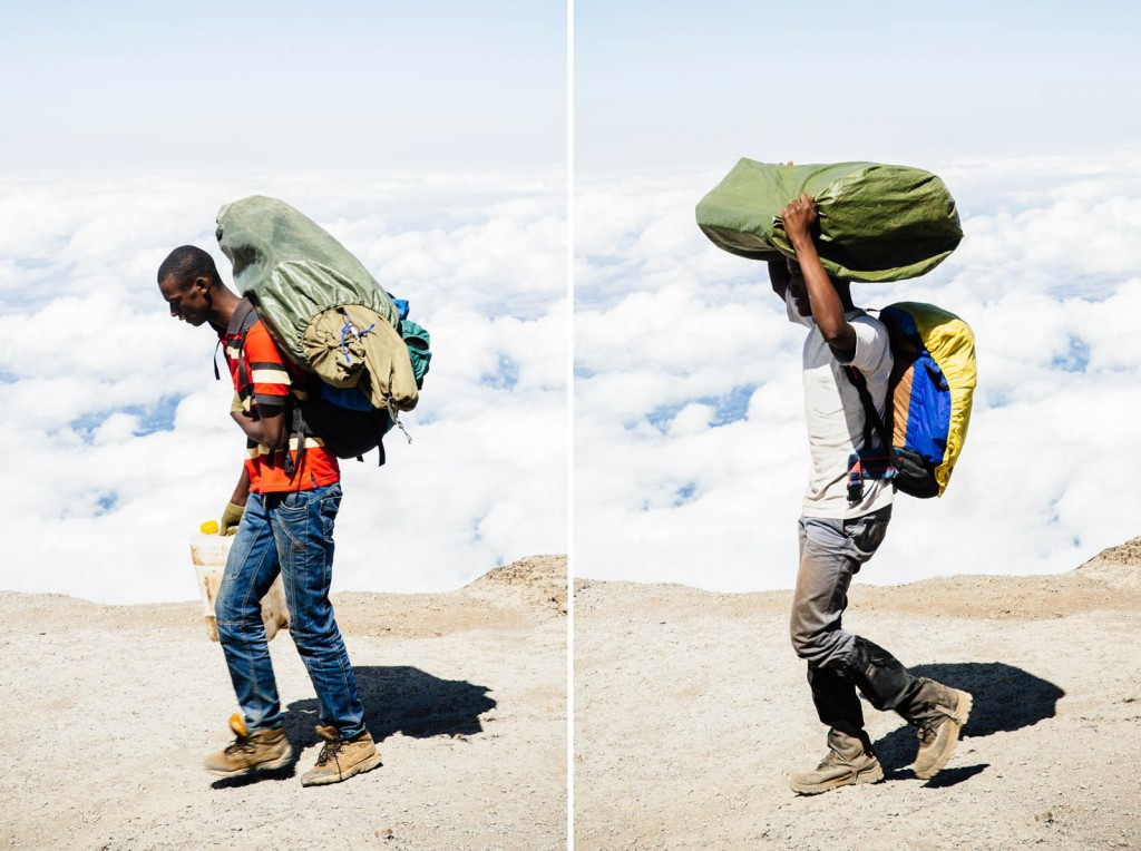 Porters walk on a ridge above the clouds on Mount Kilimanjaro – often hauling as much as 30kg.