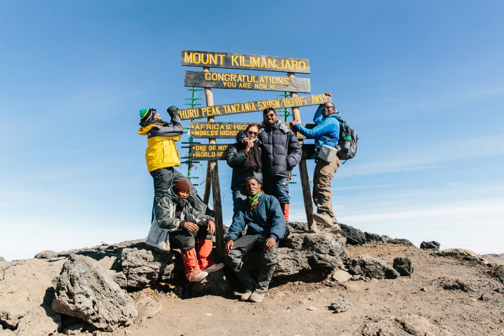 The author and photographer, Tanveer Badal, with their summit team on Uhuhu Point – Kilimanjaro's pinnacle and Africa's rooftop.