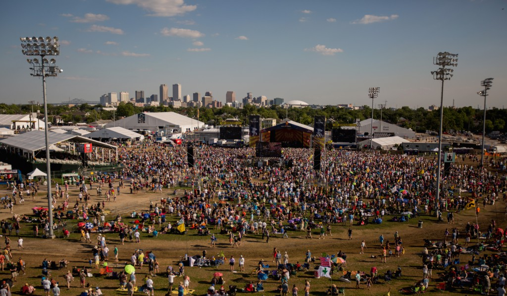 Aerial view of the crowd in a large field at the New Orleans Jazz Festival