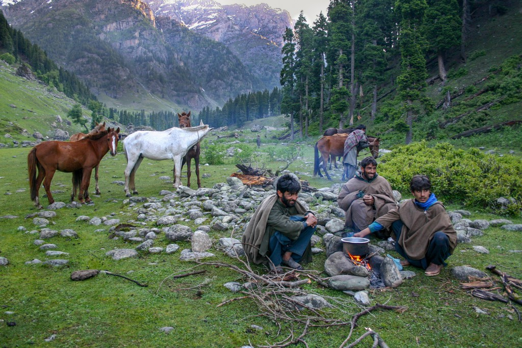 Gujjar men rest after a day of packing trekker's camping gear through the mountains. Lidderwat, Kashmir, India.