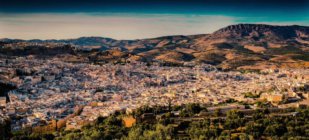 A long distance view of a city in Morocco stretching out to hills in the distance