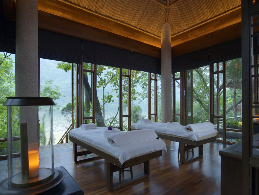 Two sumptous massage tables in a room open on all sides overlooking a forest at Brilliant Resort & Spa Chongqing China Wellness Retreat