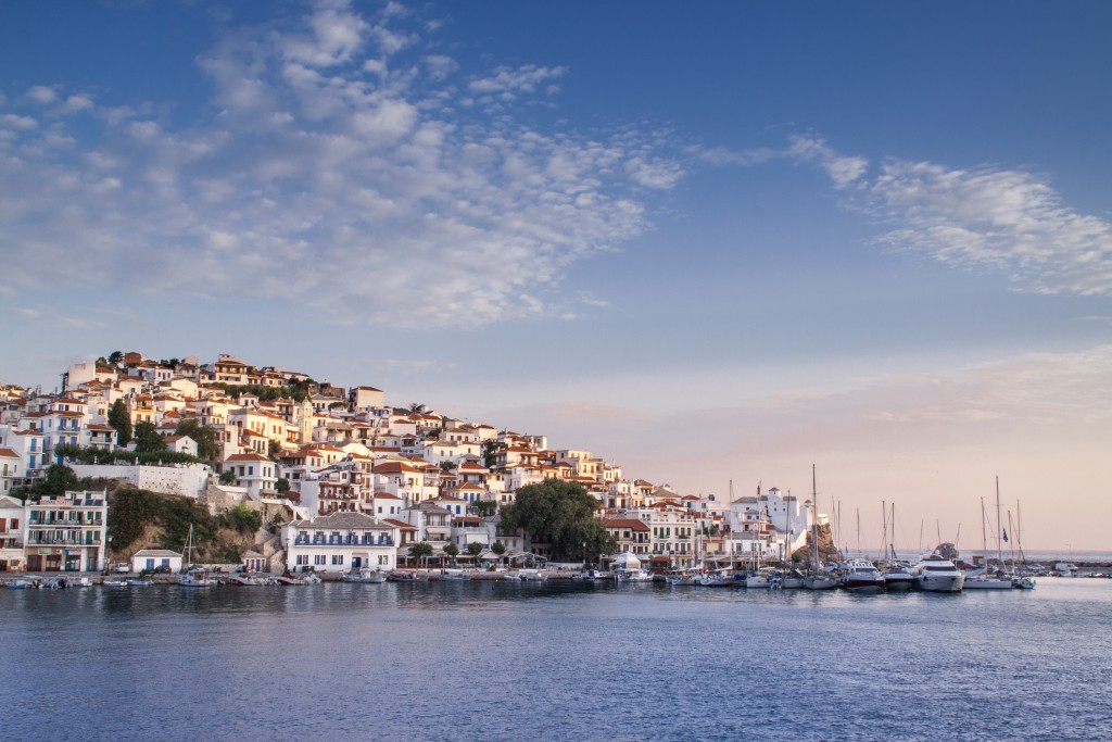 Skopelos town during sunrise, Greece As one of the greenest islands in the Aegean Sea with a diverse wildlife and mild climate year-round, it is easy to see why Skopelos is so attractive to retirees looking for a blissful hideaway. The white stone houses overlooking sapphire waters and golden beaches, radiate the holiday feel that many seek. Living and housing costs are affordable, even more so as Greek's financial crisis unfolds, and this can only make the Greek idyll a more realistic dream. Photo by Laura Zulian