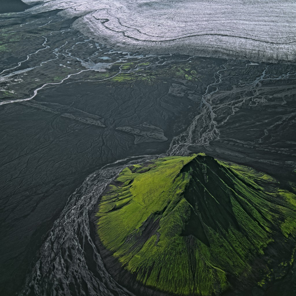 Maelifell, Iceland Maelifell, the remnant of a proud volcanic cone, is constantly washed by melt water flowing from Myrdalsjökull. It is just 100 metres high and covered by a thick layer of green spring moss.