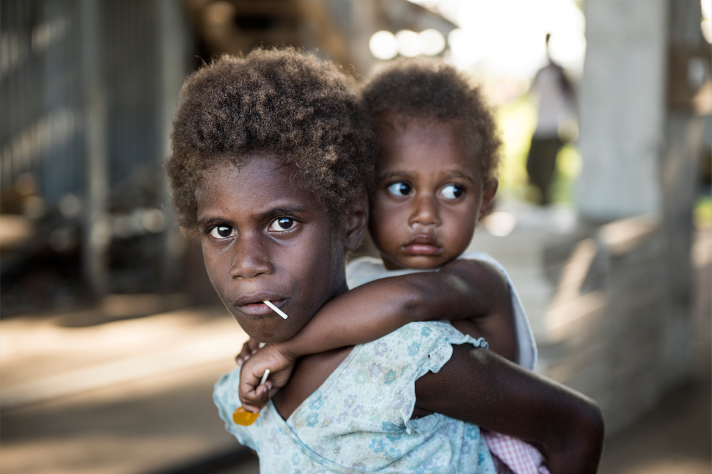 Siblings wait for treatment at a make-shift medical station, Vanuatu. Photo by Thai Neave