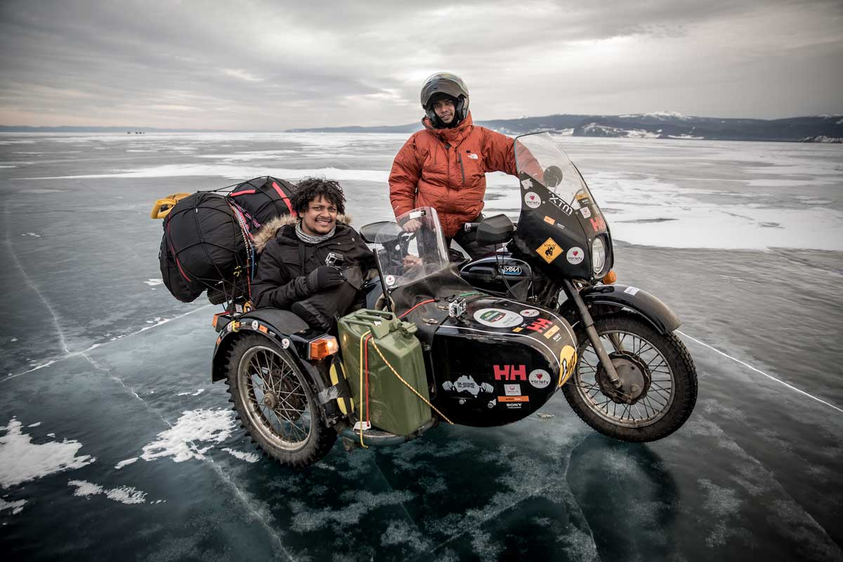 Two men, their bike and their supplies parked on the ice in Siberia
