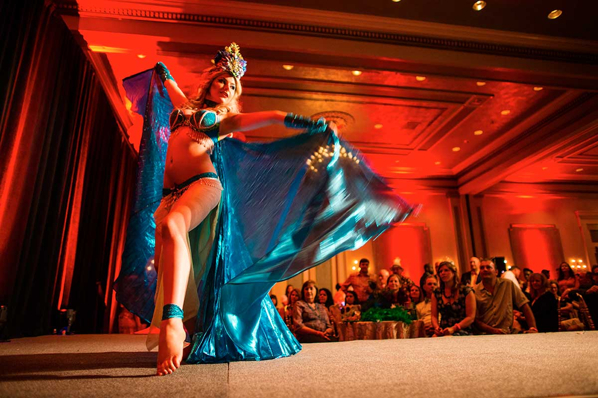 Lady in a skimpy blue costume dancing on stage, New Orleans