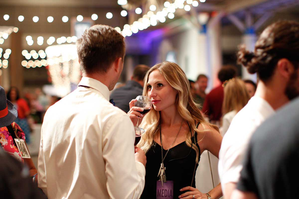 A couple gazing into each others' eyes drinking wine, New Orleans Food and Wine Festival