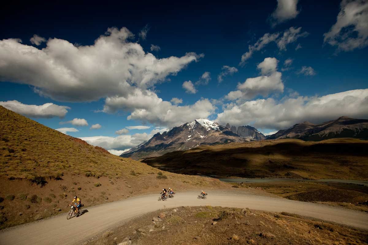 Cyclists going round a dusty bend on the Patagonian Expedition Race