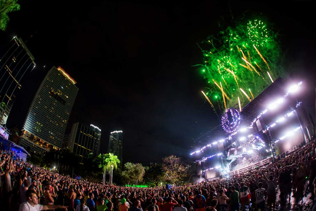 Green fireworks off the Ultra festival stage and the crowd watching