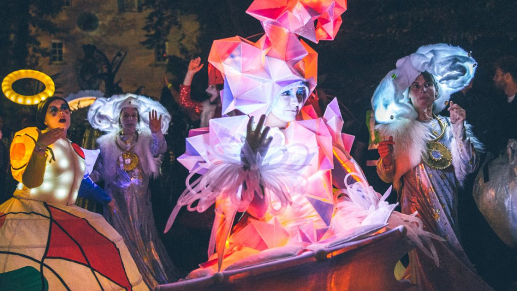 Performers in lighted up costumes