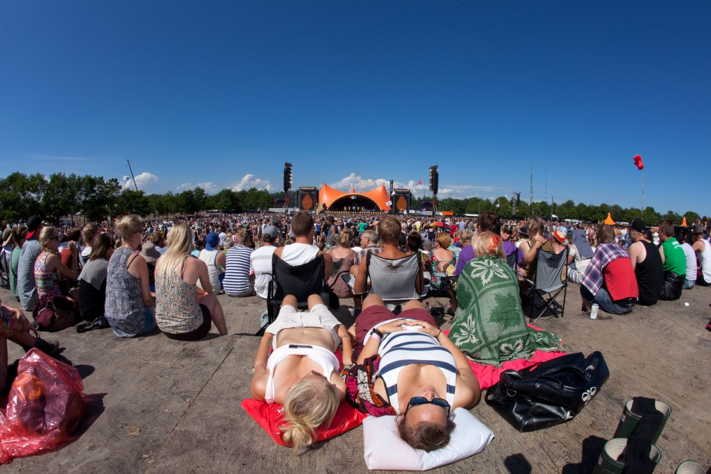 Two people lying down in the massive crowd