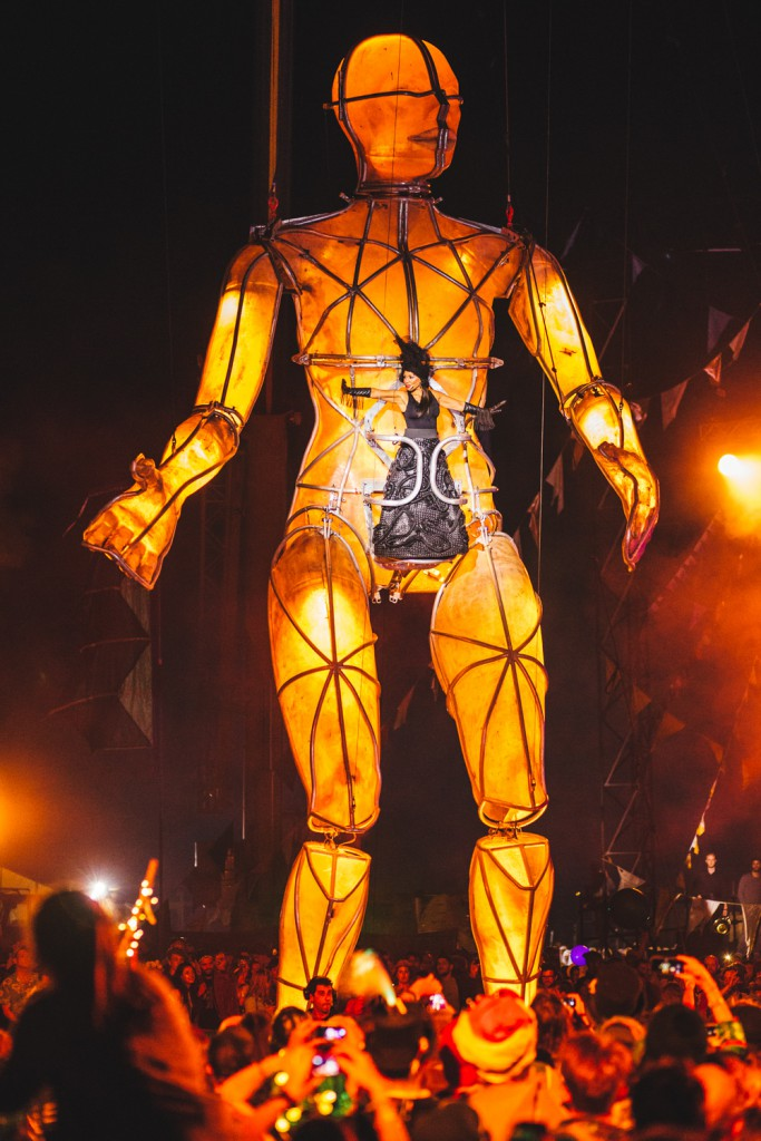 Giant forty metre puppet with a female performer strapped to its middle