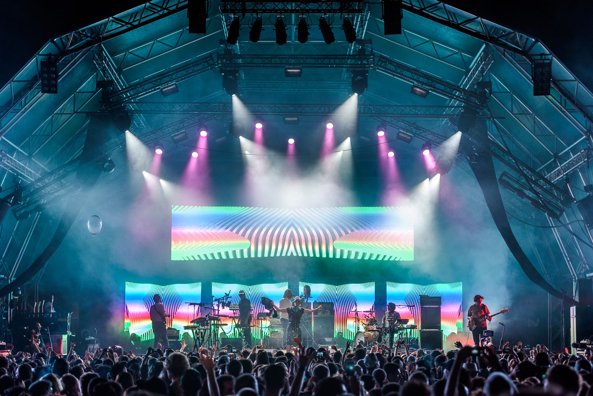 Band performing on a very psychedelic stage to the crowd at SonarD, Barcelona