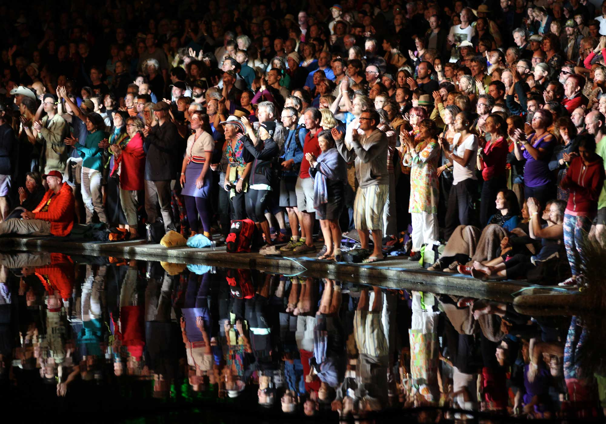 Audience reflected in the water at WOMAD