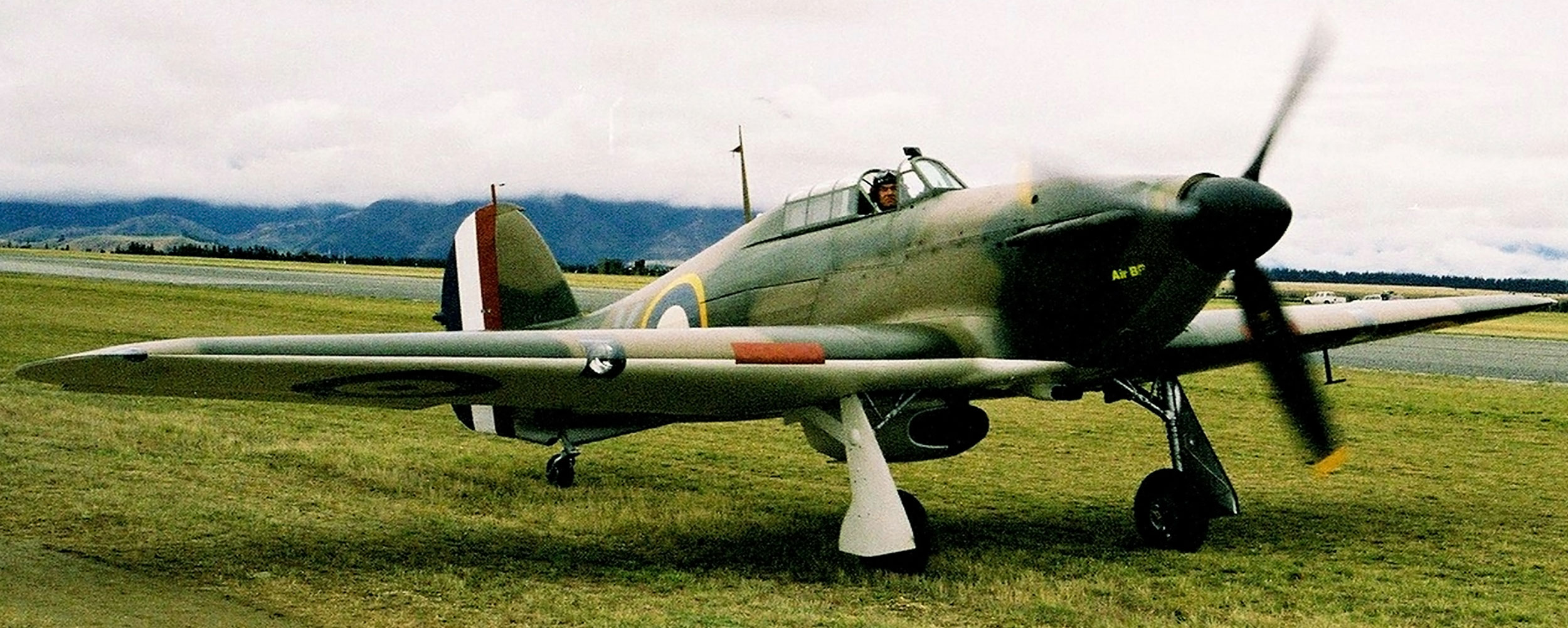 A hurricane war plane on ground with its propeller going at Wanaka, New Zealand