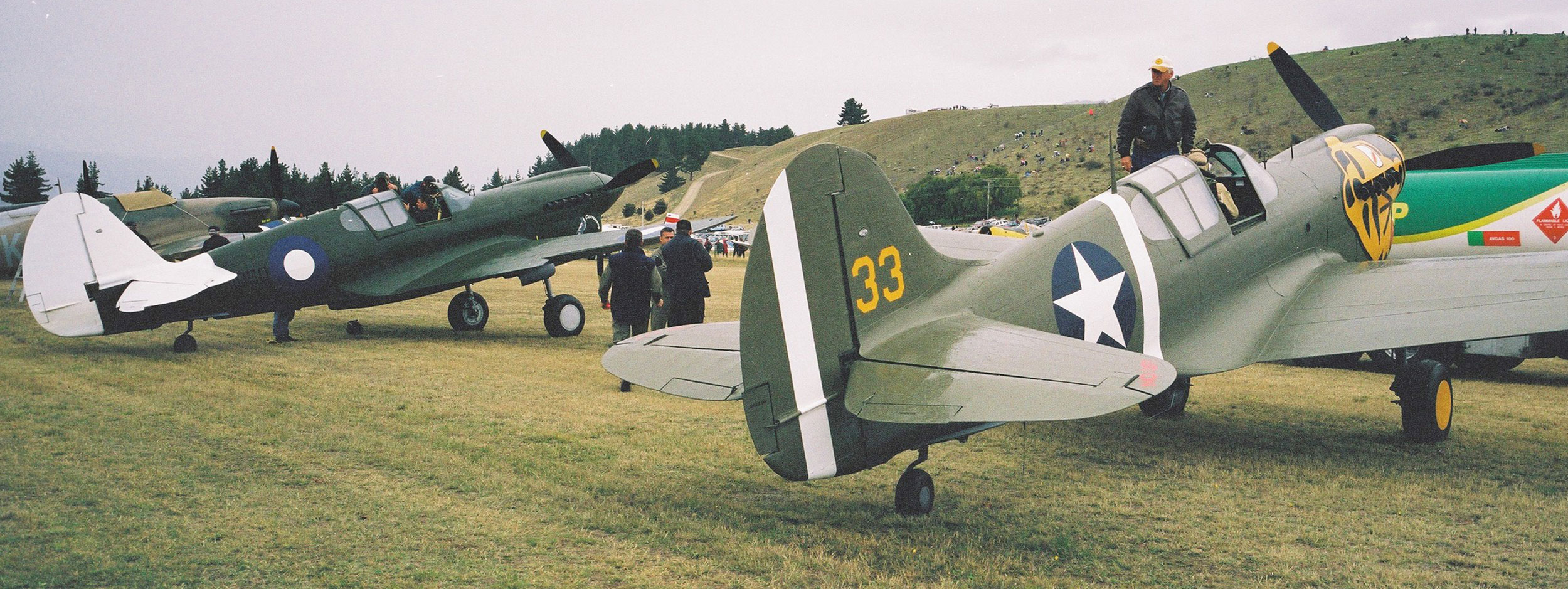A view of the Kitty Hawk and another war plane from the rear out to the hills of Wanaka