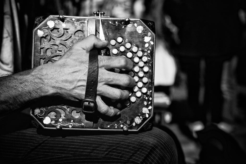 Bandoneon Hand The bandoneon ( a type of concertina) is an unwieldy and complex instrument. Each side has a multitude of buttons that are pressed while pulling or pushing the instrument apart or together. To further complicate matters, the layout of the keys is different for the right and left hands, and also different when compressing or expanding the instrument.