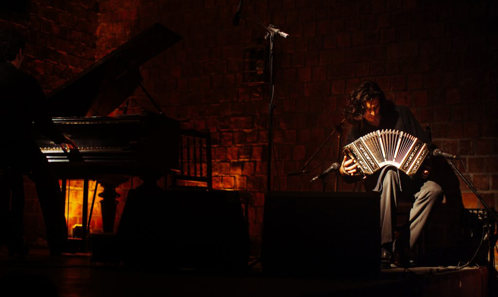 Bandoneonista A fantastic tango show in Buenos Aires has incredible dancers and musicians. Here a beam of light illuminates the bandoneon during a tango performance at the Café Gran Tortoni as the bandoneonista chops out a rhythmic measure by bouncing the instrument on one thigh.
