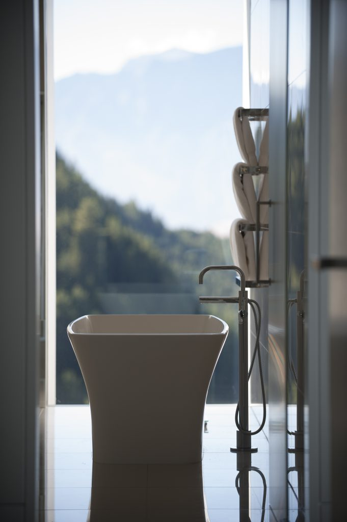 White, freestanding bath with a view of the Remarkables.