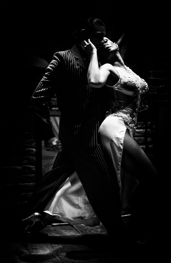 Tango power Dancers entwine at the Café Domingo in Buenos Aires. The show is free, in a miniscule venue on a perfectly picturesque plaza in San Telmo — the heart of Argentine tango.