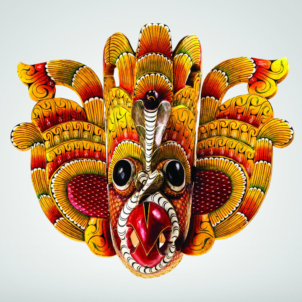 A colourful demon mask used in Sri Lankan carnivals