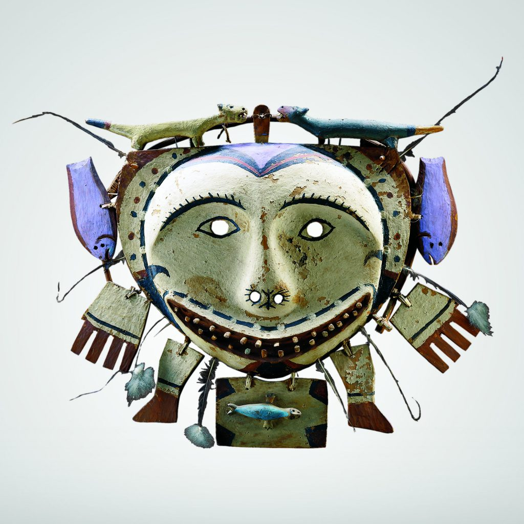 An Eskimo mask made of wood, feathers, pigments, vegetal fibres