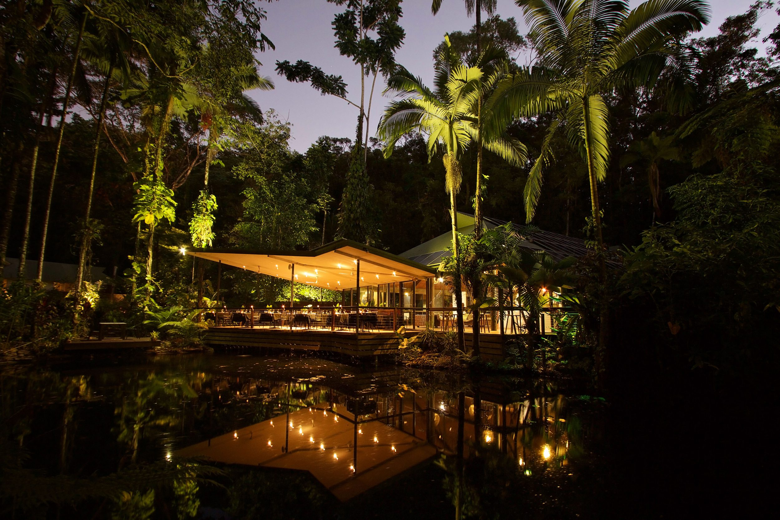 Julaymba Restaurant of Daintree Eco-resort reflected in water at night