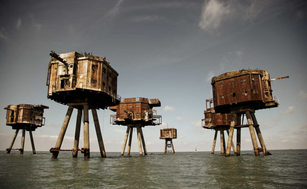 Maunsell Sea Forts, United Kingdom The Maunsell sea forts in the Thames and Mersey Estuaries have long been left alone to rust and decay. These remarkable army and naval forts were built during the Second World War but had a short period of actual operation. The forts have had unique and fascinating lives, from being pirate radio sites to facing attack by vandals and collisions with wayward vessels. Although some of the forts have been defeated by time and other 'enemies', several stubbornly persist. Now the only steadfast visitors that these concrete sea creatures regularly have are the squawking birds that ride the surrounding swell. Many of the forts are deemed too unsafe to enter, though it is possible to admire them from the boats that occasionally visit and more often pass by. Photo by Daniel Jones