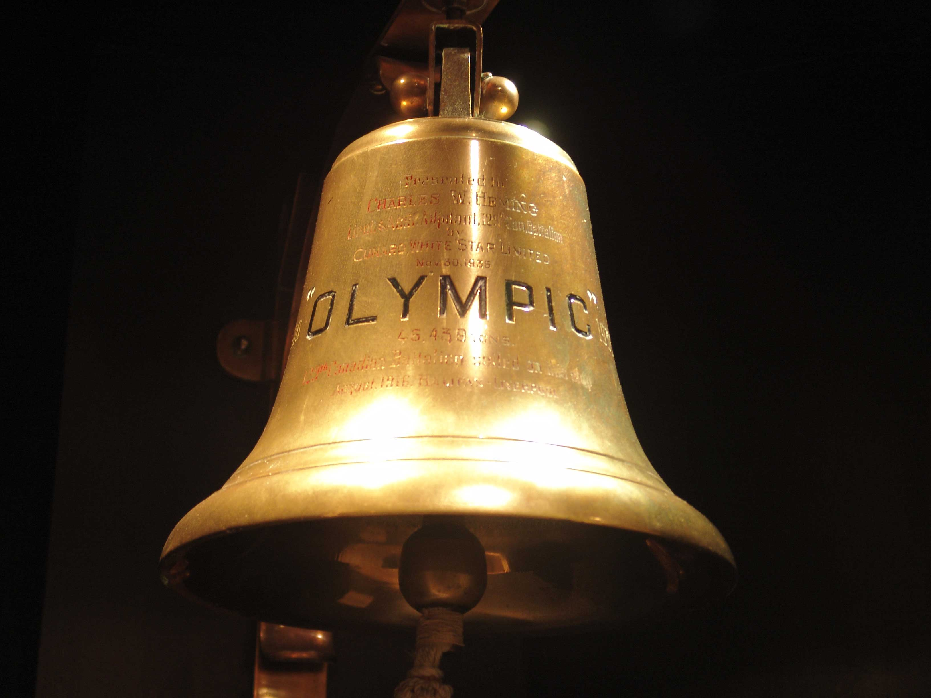 A brass bell inscribed with the word Olympic
