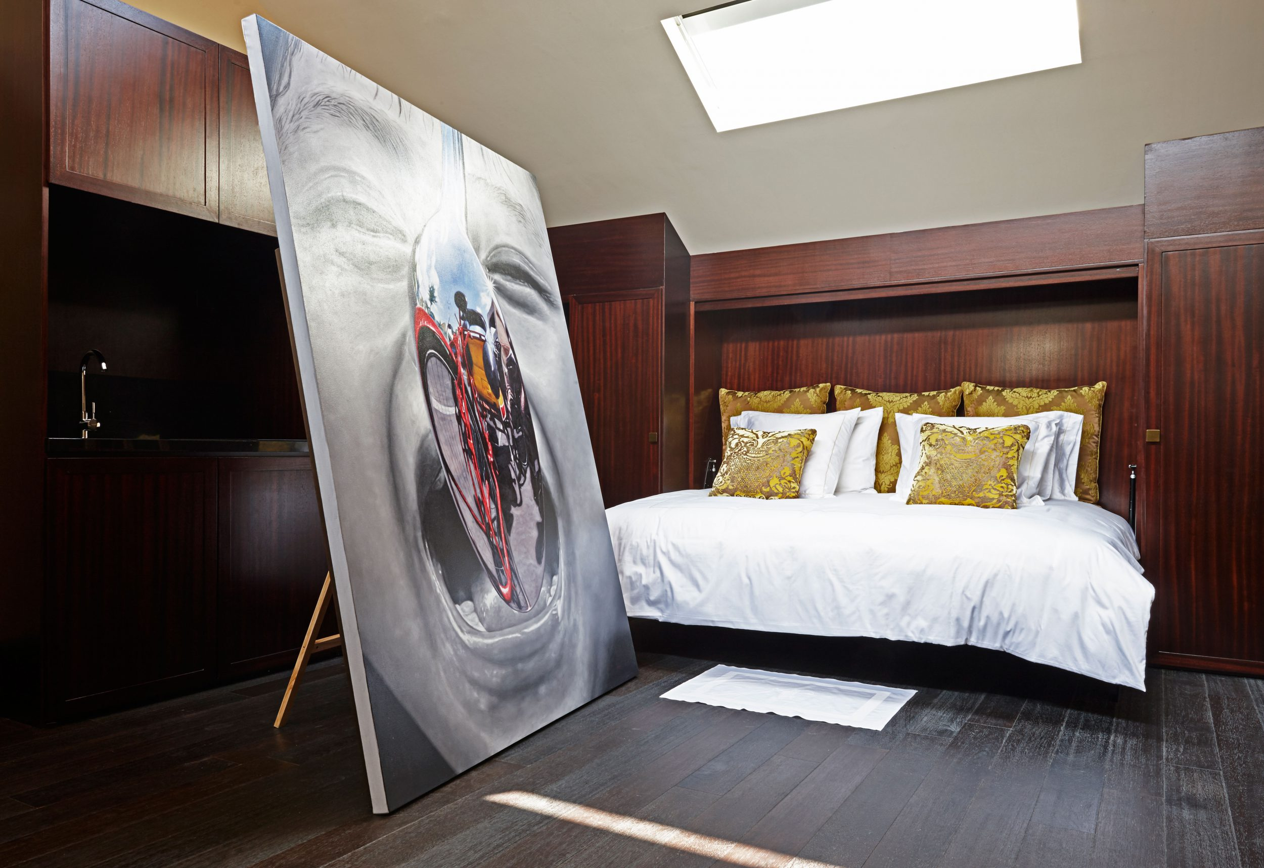 Huge painting by a bed in a art suite of Hotel Vagabond, Singapore