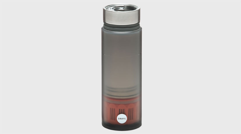 Close up of a grey Grayl water filter bottle with a metal cap